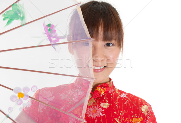 Chinese cheongsam girl with umbrella Stock photo © szefei