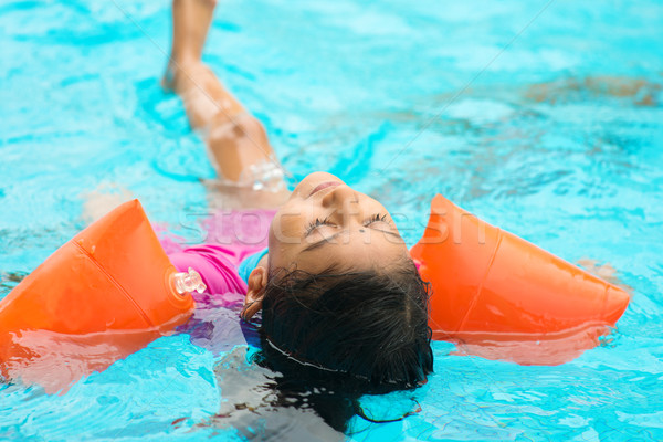 Little girl swimming Stock photo © szefei