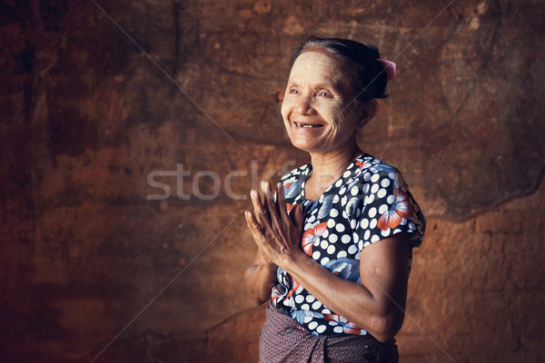 Portrait of traditional Asian Burmese woman greeting, standing inside a temple, low light, Bagan, My Stock photo © szefei