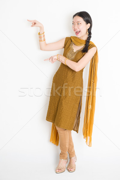 Mixed race Indian Chinese woman fingers indicating Stock photo © szefei