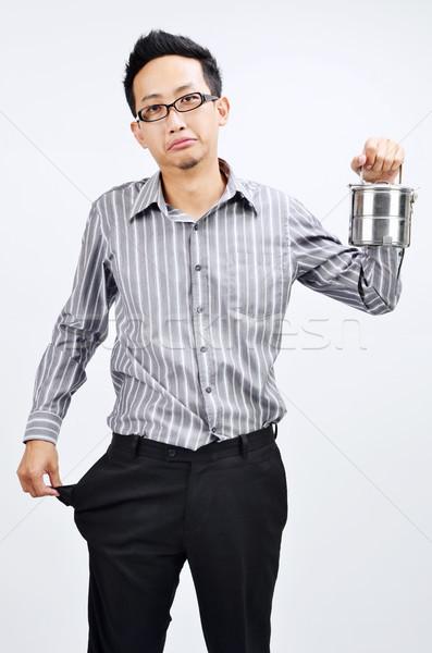 Empty pocket Asian businessman and lunch box Stock photo © szefei
