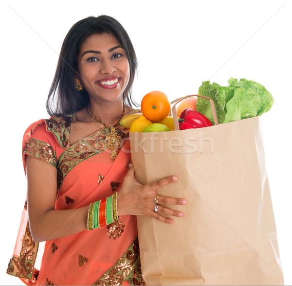 Indian woman having groceries shopping Stock photo © szefei