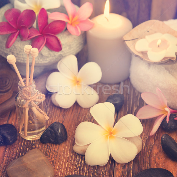 Spa treatment setting with frangipani Stock photo © szefei