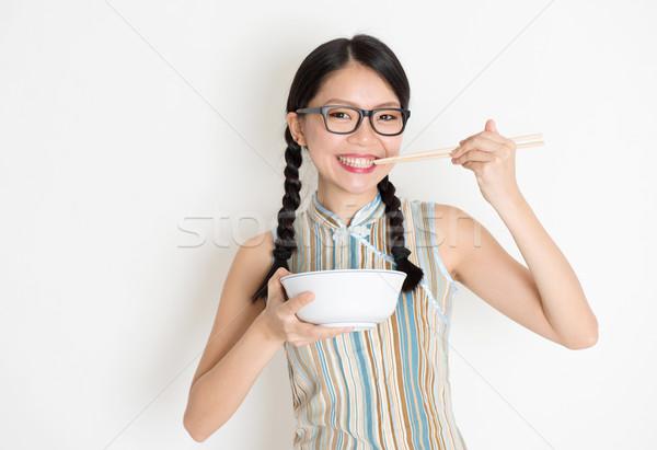 Asiático chinês feminino alimentação retrato Foto stock © szefei