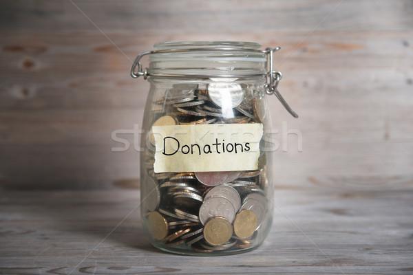 Dinheiro jarra doações etiqueta moedas vidro Foto stock © szefei