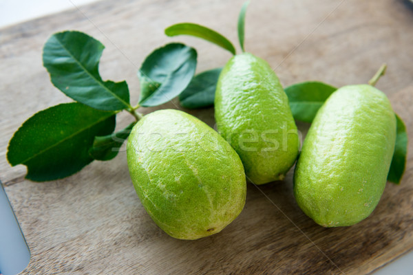 Fresh organic green lemons Stock photo © szefei