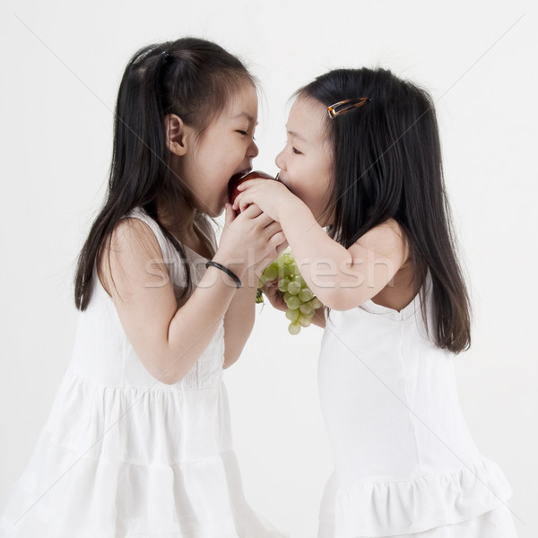 Biting apple Stock photo © szefei