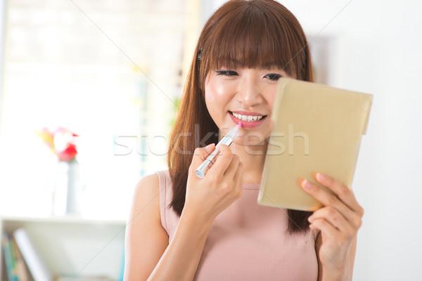 Applying cosmetic Stock photo © szefei