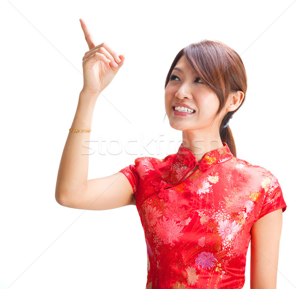 Chinese girl pointing at blank space Stock photo © szefei