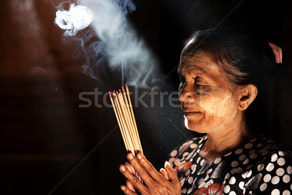 Praying with incense sticks  Stock photo © szefei