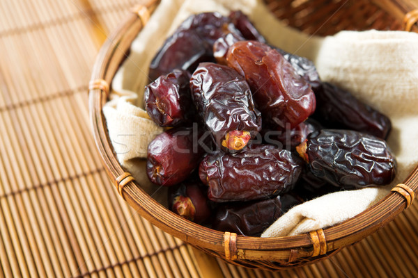 Dried date palm fruits  Stock photo © szefei