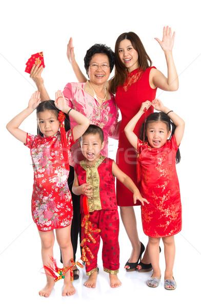 Asian Chinese family wishing you a happy Chinese New Year Stock photo © szefei