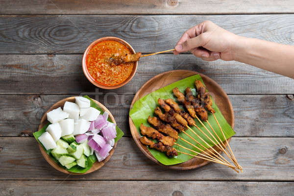 People eating sate Stock photo © szefei