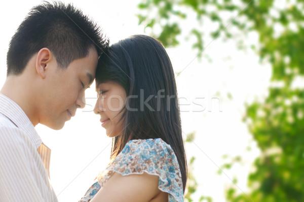 Szerető pár fiatal pér szeretet szemtől szembe naplemente Stock fotó © szefei