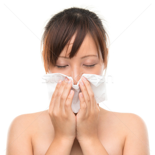 Flu or cold - sneezing woman sick blowing nose.  Stock photo © szefei