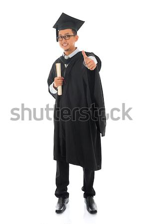 Asian male university student in graduation gown thumb up  Stock photo © szefei
