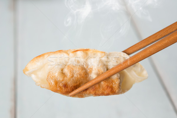 Asian cuisine pan fried dumplings Stock photo © szefei