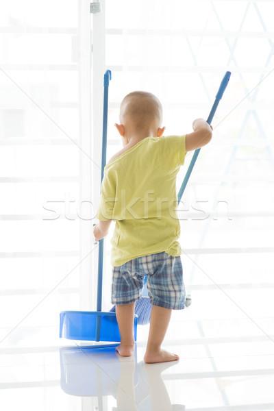 Asian toddler sweeping floor Stock photo © szefei
