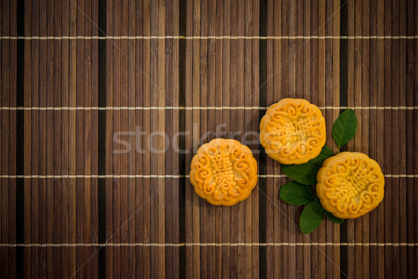 Top down mooncakes on bamboo mat with copy space Stock photo © szefei
