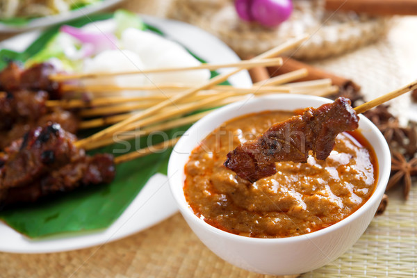 Satay skewered and grilled meat Stock photo © szefei