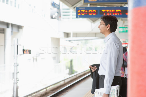 Indian businessman waiting train Stock photo © szefei