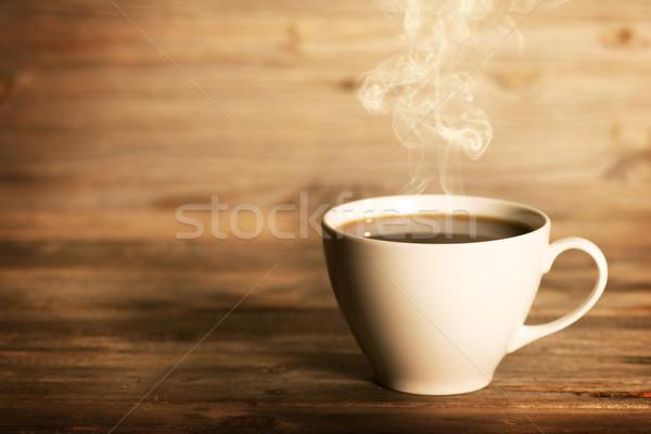 Steaming coffee in white mug Stock photo © szefei