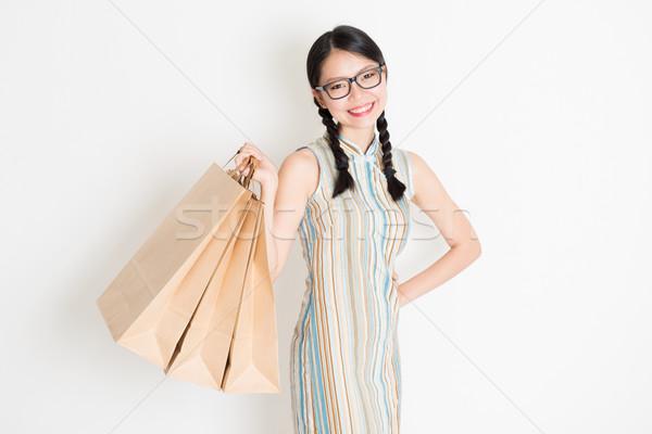 Oriental female shopping Stock photo © szefei