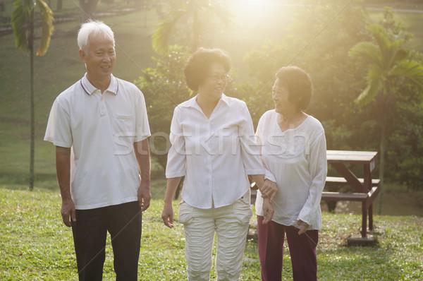 Group of Asian seniors walking at nature par Stock photo © szefei