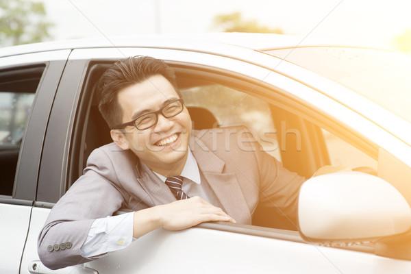 Happy driver on the road Stock photo © szefei