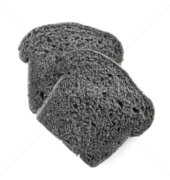 Black charcoal bread slices Stock photo © szefei
