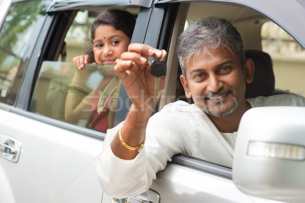 Indian man showing his new car key. Stock photo © szefei