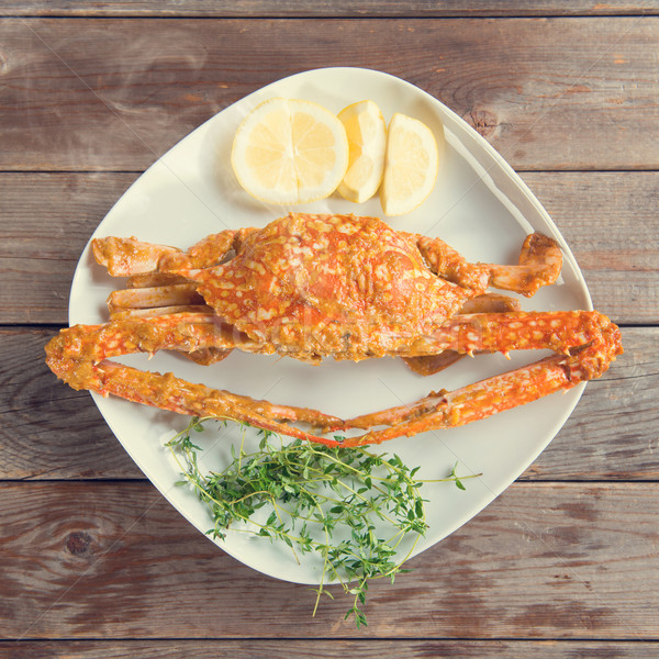 Hot and spicy sauce blue crab in vintage Stock photo © szefei