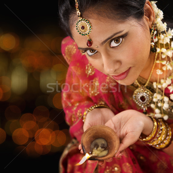 Indian woman hands holding diwali light Stock photo © szefei