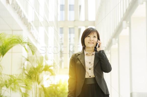Young Asian business woman talking on phone Stock photo © szefei