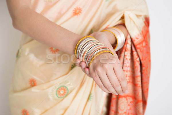 Woman in Indian sari dress wearing bangles Stock photo © szefei