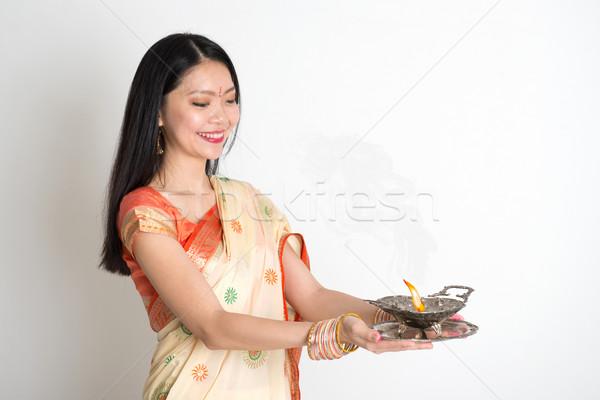 Female with Indian sari dress holding oil lamp Stock photo © szefei