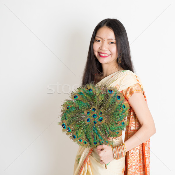 Young girl with peacock feather fan in Indian sari dress Stock photo © szefei