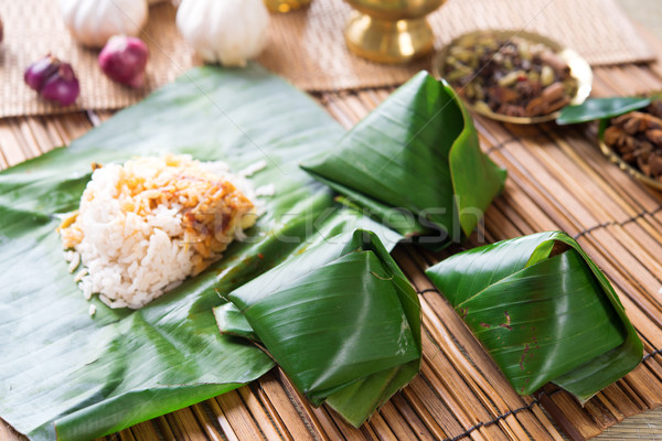 Nasi lemak wrapped with banana leaf. Stock photo © szefei