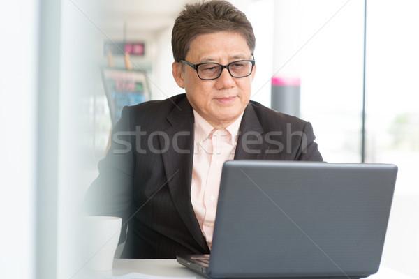 CEO boss using internet with laptop Stock photo © szefei