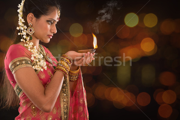 Indian girl hands holding diwali lights Stock photo © szefei