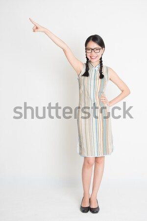 Asian girl finger pointing away Stock photo © szefei
