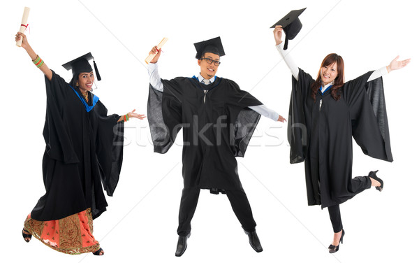Multi races university student in graduation gown jumping Stock photo © szefei