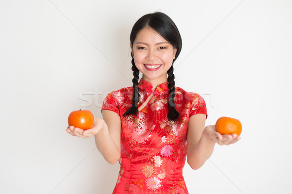 Asian chinese girl holding tangerine  Stock photo © szefei