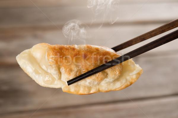 Chinese meal pan fried dumplings Stock photo © szefei