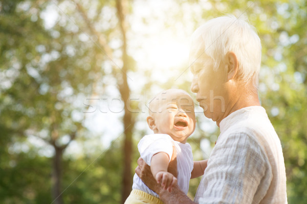 Grandfather and crying grandson. Stock photo © szefei