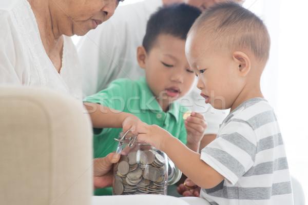 Family saving coins concept Stock photo © szefei