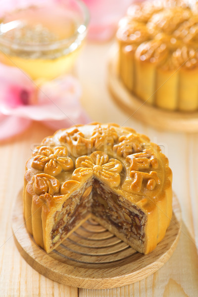 Assorted fruits nuts mooncakes with tea Stock photo © szefei