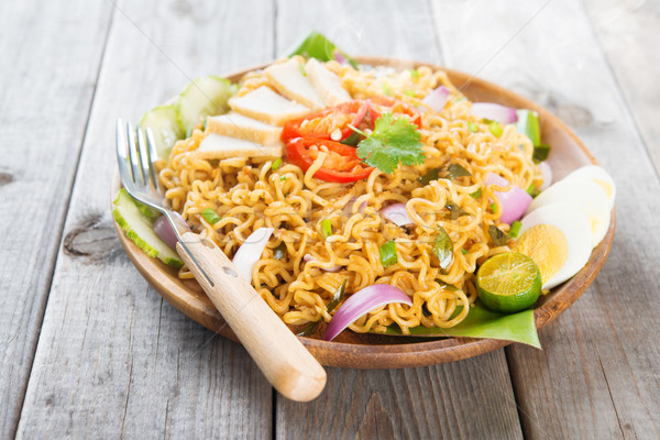 Asian spicy fried curry instant noodles Stock photo © szefei