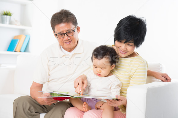 Asian family reading Stock photo © szefei