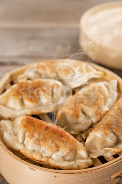 Chinese gourmet pan fried dumplings Stock photo © szefei